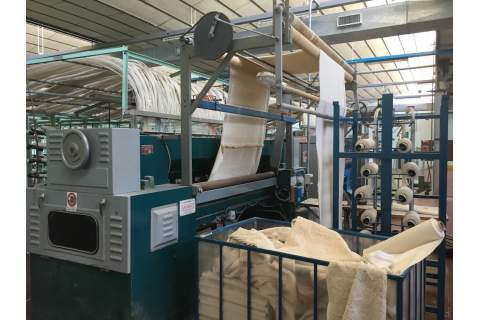 Pickering tufting machine for bath carpet